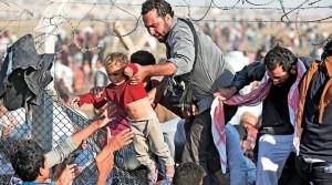 Syrie enfant passage barbelés